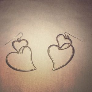 A pair of heart earrings